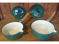 Two green cast pans