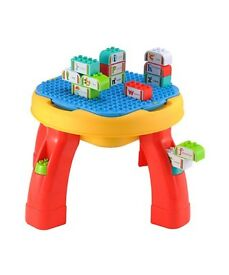 Building activity table with alphabet blocks (from ELC)