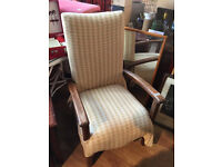 Older style armchair with curved wooden handles , lovely shape.