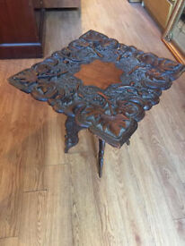 Oriental Table in very good condition. Lovely carved detail. size 18 in x 18 in x 18 in