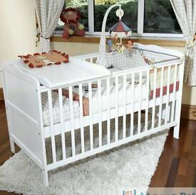 White cot with changing topper
