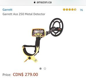 Metal detector  Garrett Ace 250 with rain protection cover.