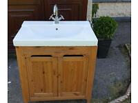 Bathroom sink and cabinet complete with tap