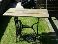 Singer sewing machine cast iron frame converted to garden table