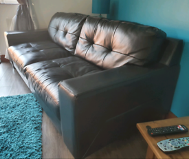 Large high quality black leather sofas