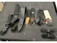 Job lot used guitar bags, straps and cables