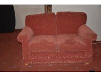 Two seater sofa, red in colour. Good condition - fire retardant labelled