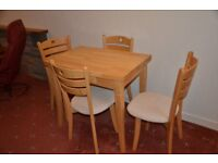 Extending table with four chairs