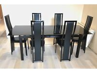 Modern dining room set in black metal and glass plus matching living room tables