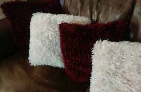8 Fluffy Cushions. 4 of each Cream and Wine Red
