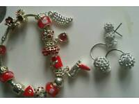 Red bracelet and ear rings brand new