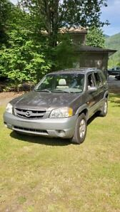 2002 MAZDA TRIBUTE .THE BEST PRICE IN THE VALLEY