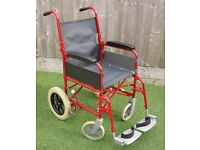 Wheelchair black/red transit folds up small, fits in most car boots.
