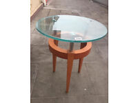 Glass table with wooden feet, in good condition. size Diameter 19 Lamp/occassional table