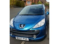 Peugeot 207, brilliant first car! Great on fuel and cheap tax and insurance.