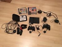 Title Black PlayStation 2 Slim plus 21 games