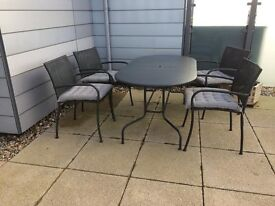 Garden table with 4 chairs, Garden bench and various plants