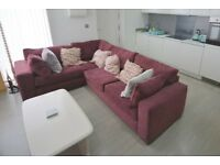 Left hand return corner sofa - wine colour. COLLECTION ONLY.