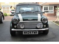 1994 M Rover Mini Cooper 1.3. British Racing Green with fully opening electric sunroof