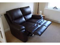 Two seater reclining sofa.