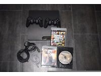 Ps3 Slim 160 GB , 2 Controllers and with GTA 5 , Uncharted 3 and WWE 12