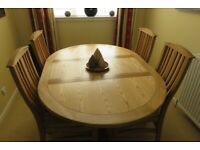 Solid Oak Round extendable dining table & 4 matching chairs. Excellent condition.