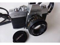 Minolta srT100X 35mm camera and lenses