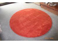 180cm diameter Burnt Orange colour rug.