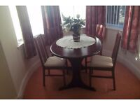 extending dining room table and 4 chairs.
