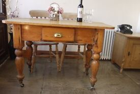 Very old rustic farmhouse pine planked pine table and two elm, beech chairs