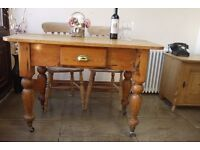 Antique old rustic farmhouse planked pine table and two elm, beech chairs. Writing desk