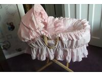 pink frilly moses basket
