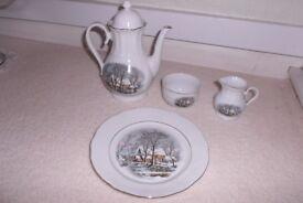 Coffee jug, milk jug, sugar bowl and plate with winter scene.