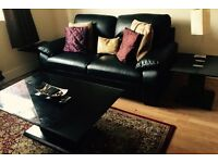 Black leather sofa set and 3 piece black coffee table set