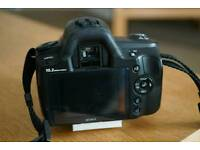 Sony a230 dslr camera with lens, charger and neck strap.