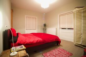 short term only. a nice furnished room in a good flat near the 7 dials.