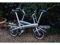Two Ixi aluminium frame collapsible bikes