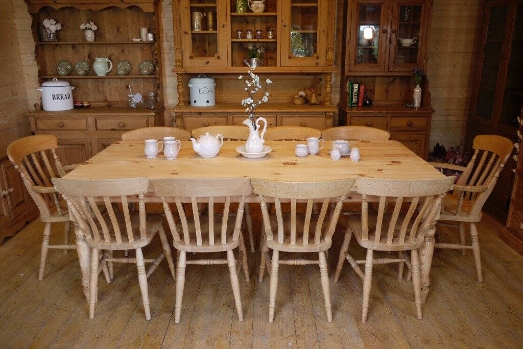 farmhouse solid waxed pine very large table and 10 chairs, 2 are carvers
