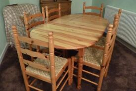 Solid pine extendable dining table with six chairs