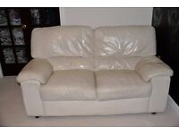 Two seat cream leather sofa - has been cleaned and serviced recently