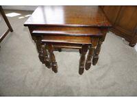 Nest of three coffee tables in dark oak colour