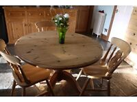 Beautiful solid waxed pine rustic farmhouse round table 3 chairs.
