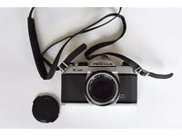 Pentax K1000, 35 mm film, single-lens reflex (SLR) camera