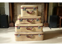 Set of 4 vintage Watajoy suitcases.