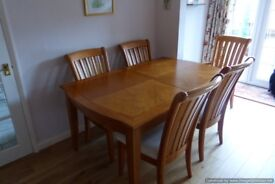 Pinehurst dining room table with 6 chairs.