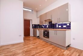 A spacious one double bedroom flat with a private patio area, situated on Tooting High Street.