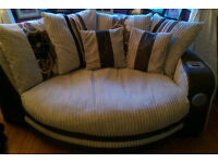 4 seat corner sofa and 2 seat snuggle sofa with sound system built in