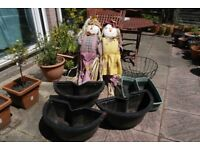 scarecrows, planters and hanging basket