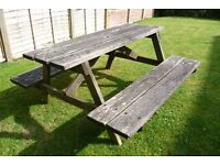 Solid Picnic Table and integral benches, in good condition, although weathered