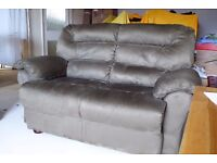 very comfy two seater sofa, finished in olive colour micro fibre material.
